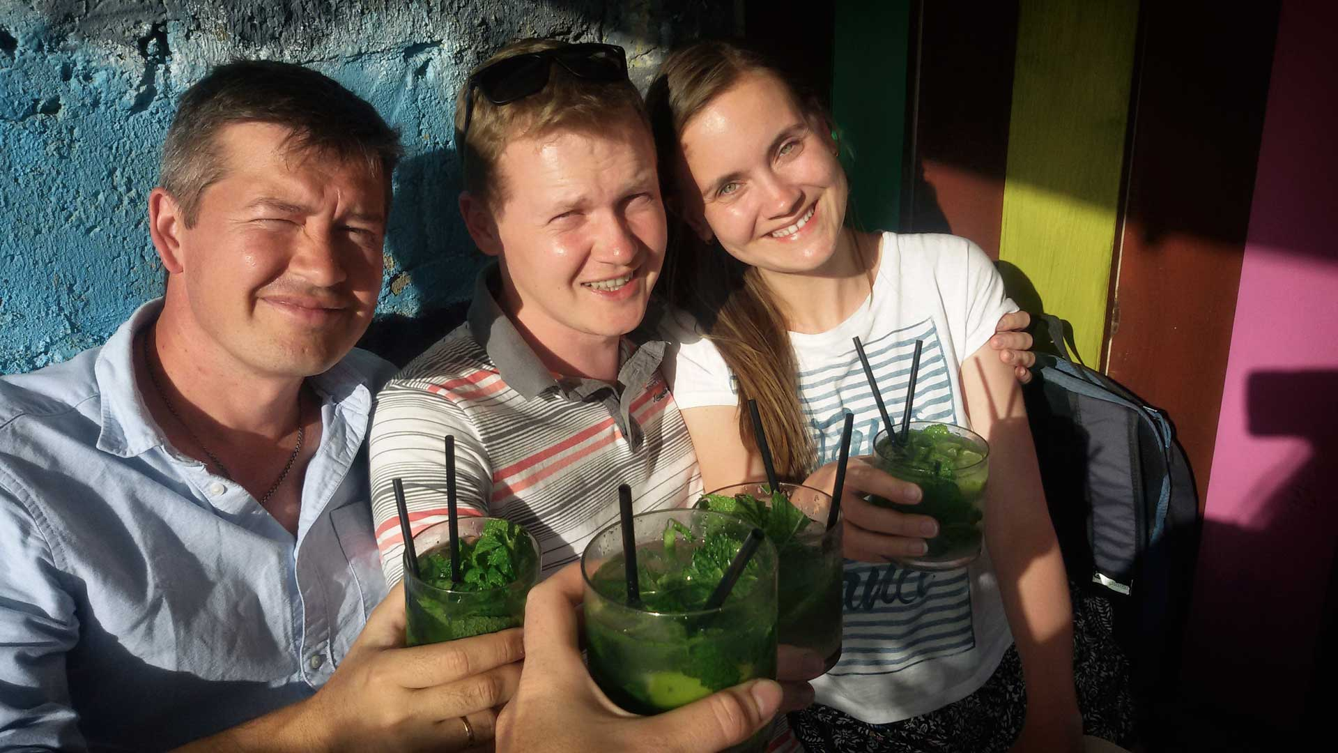 people with mojito cocktail